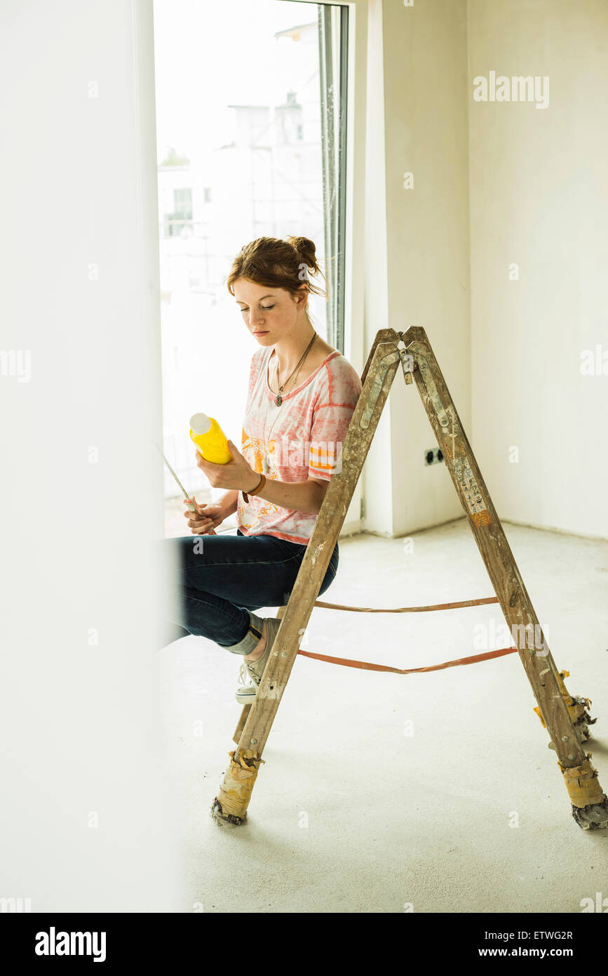 Young woman renovating - Stock Image