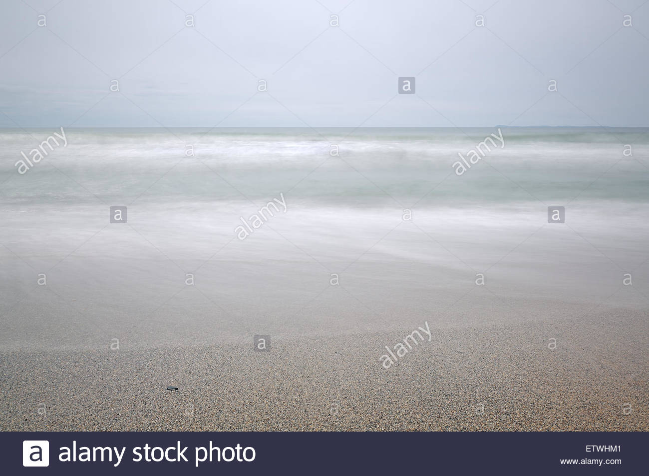 A minimalist photograph of Dunaverty beach on the south coast of Kintyre, Scotland. - Stock Image