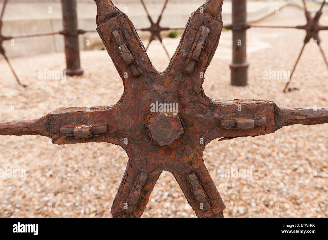 Rusting steel star brace on Dovercourt lighthouse keeping tension and metal legs in place from splaying out - Stock Image