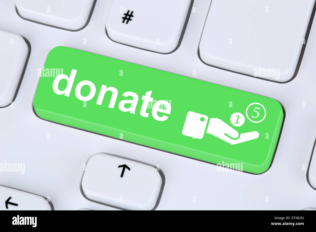 Donate money donation for a project symbol on computer keyboard - Stock Image