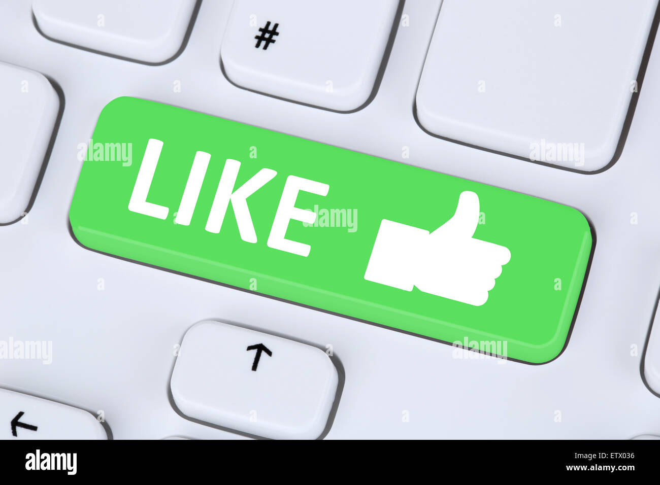 Like button icon thumb up social media or network on internet computer keyboard - Stock Image