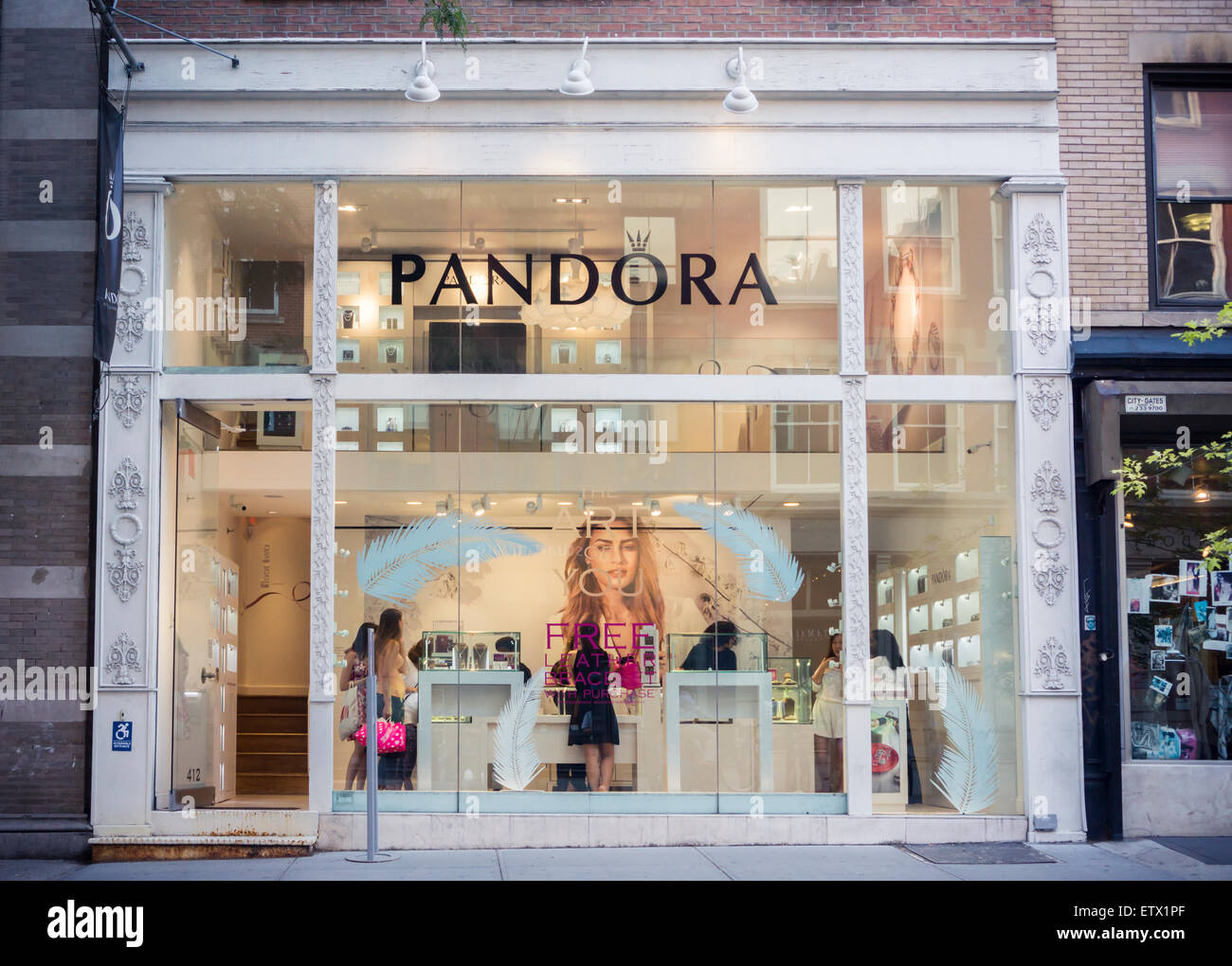 A store of the Pandora chain of jewelry stores in Soho in New York ...