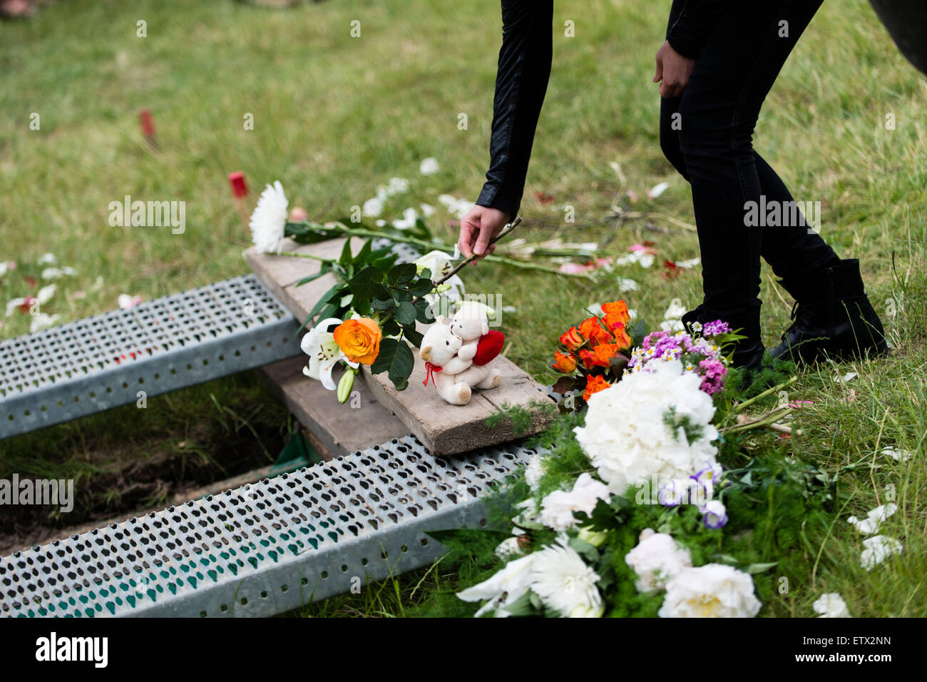 Muslim funeral grave stock photos muslim funeral grave stock mourners lay flowers at the grave site of a woman from syria who drowned in the izmirmasajfo