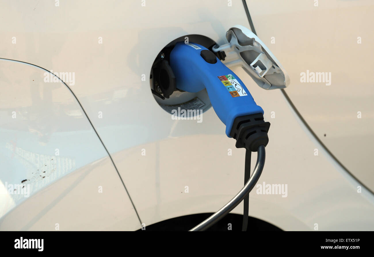List, Germany, Detail, electric car is charged - Stock Image