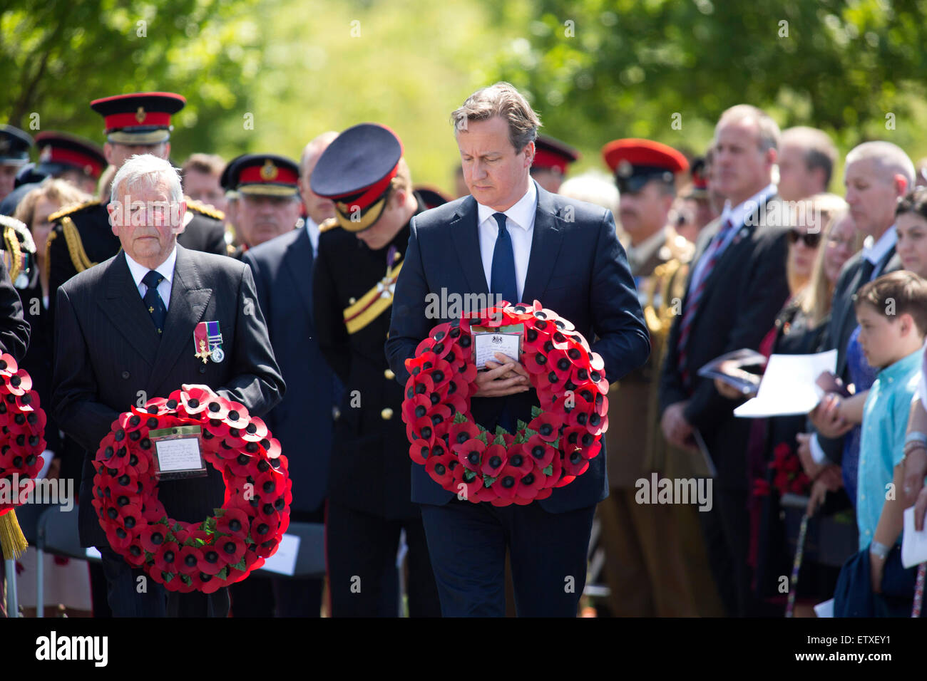 David Cameron, centre, lays a wreath during the service of rededication of the Bastion Wall at the National memorial - Stock Image