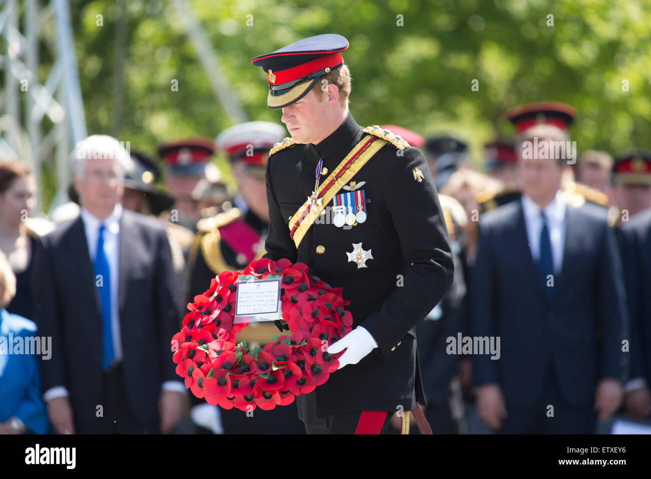 HRH Prince Harry lays a wreath during the service of rededication of the Bastion Wall at the National memorial Arboretum - Stock Image