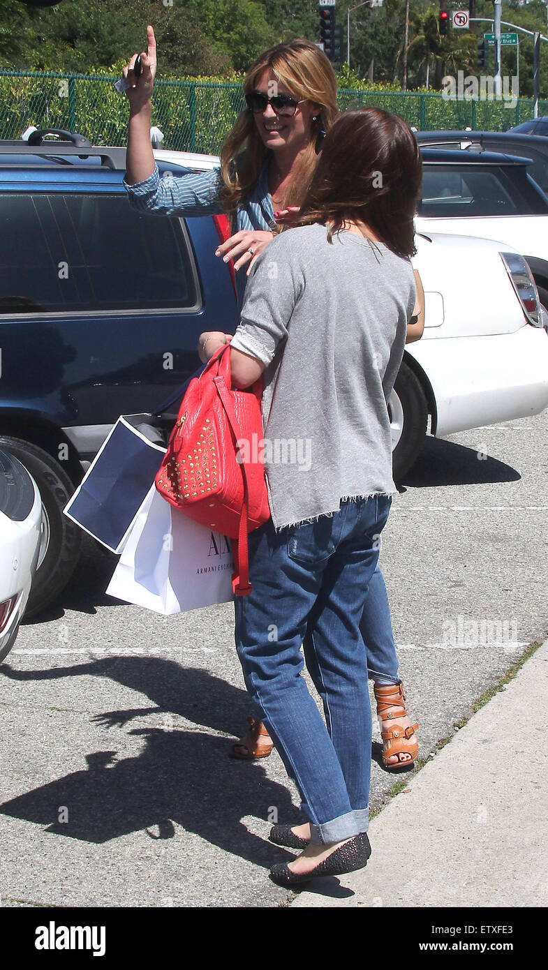 Cat Deeley highlights her long legs in skinny jeans with a pin-striped blouse as she loads up on new clothes from Armani Exchange and The A-List in Beverly Hills  Featuring: Cat Deeley Where: Los Angeles, United States When: 24 Mar 2015 C Stock Photo