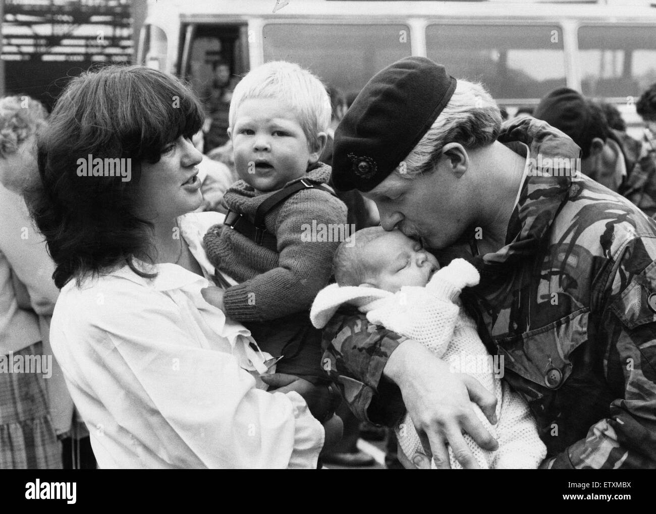 Marine Andrew Riley delighted to see his baby son Darren 4 weeks old born while Andrew was in Falklands, with wife - Stock Image