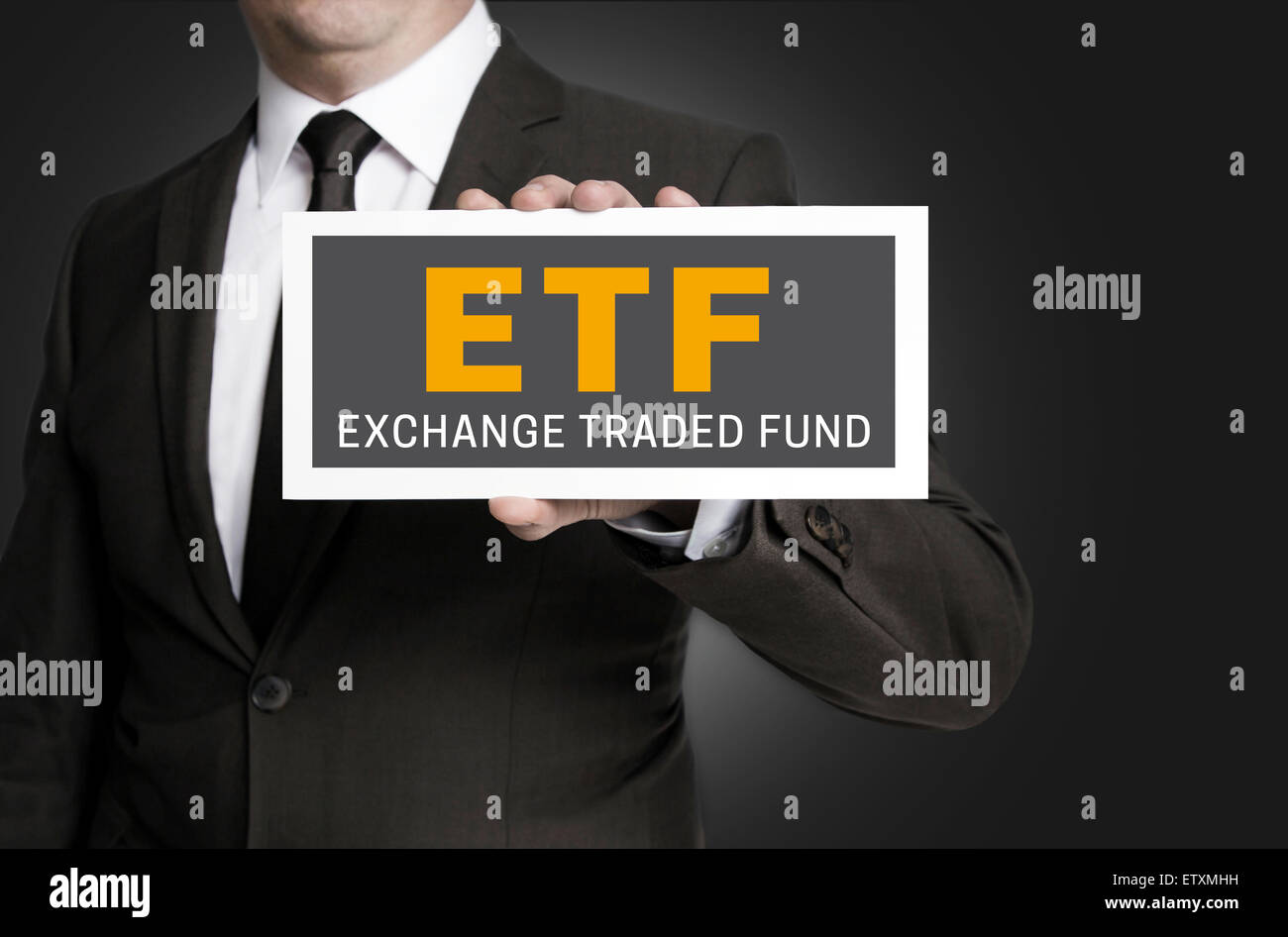 ETF sign is held by businessman. Stock Photo