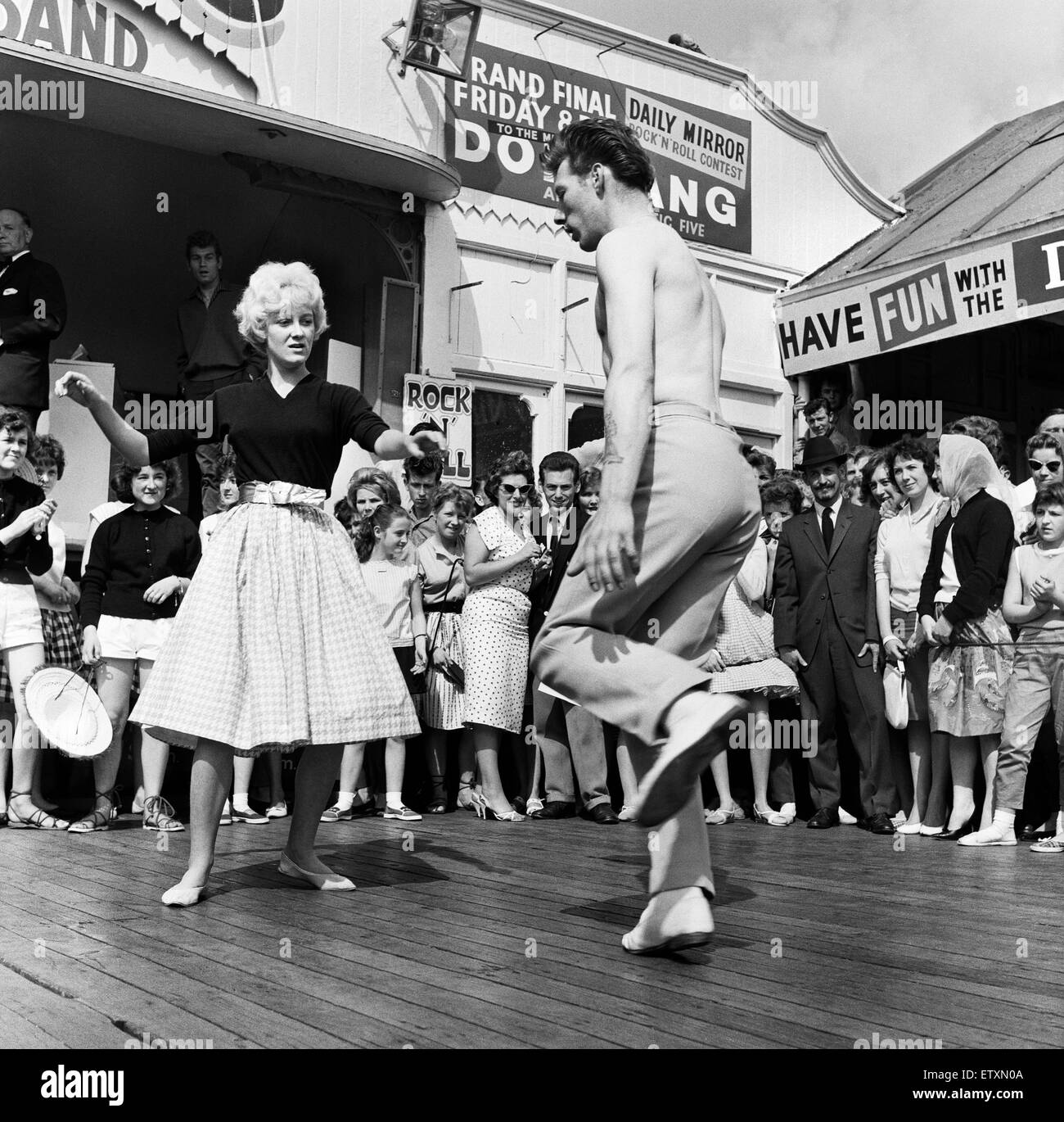 Dancing during a rock and roll session on the central pier in Blackpool, Lancashire. 4th August 1960. - Stock Image