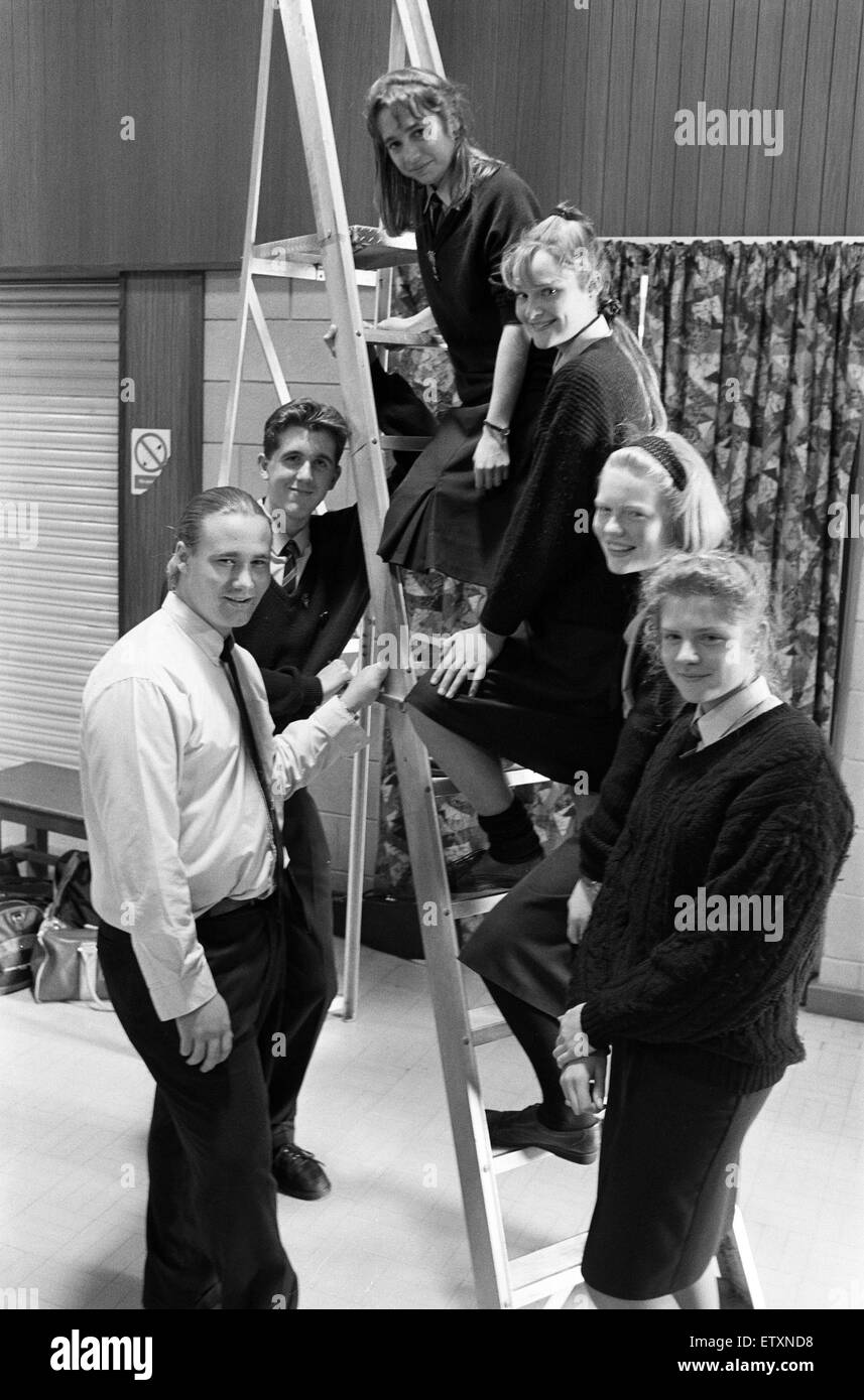 Climbing the ladder of success are Brighouse High School pupils (from left) Carl Criscione, Robert Stepney, Sarah - Stock Image