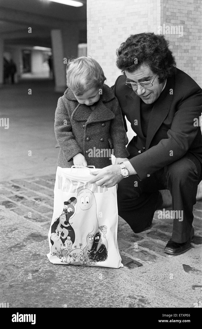 A Young Christmas shopper with his dad in Birmingham. 20th December 1975 - Stock Image