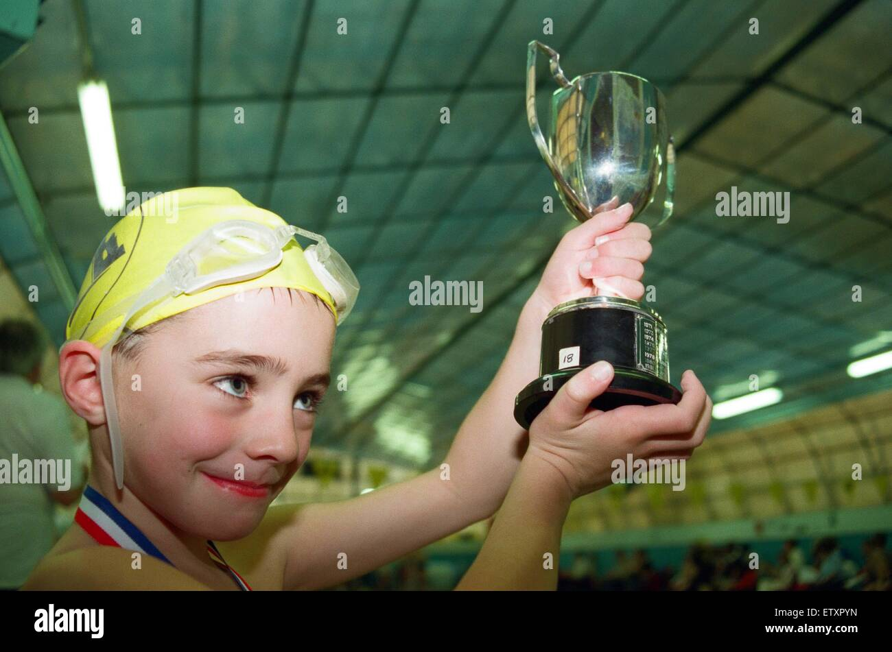 Action at the Guisborough Swimming Club Gala - Winner Christopher Wilkinson showing off his trophy. 16th November - Stock Image