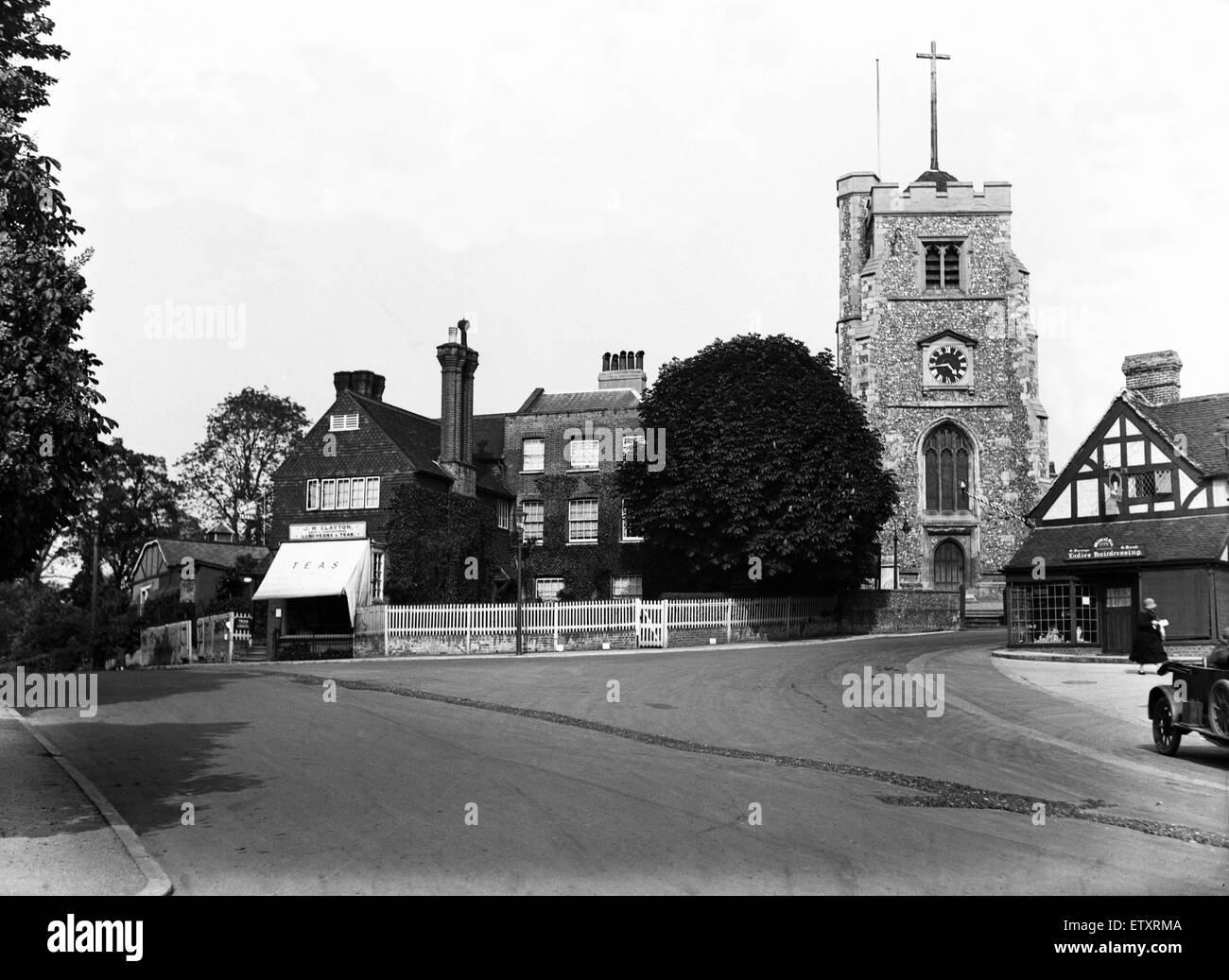 St John the Baptist Church and High Street Pinner, London. Circa 1930 - Stock Image
