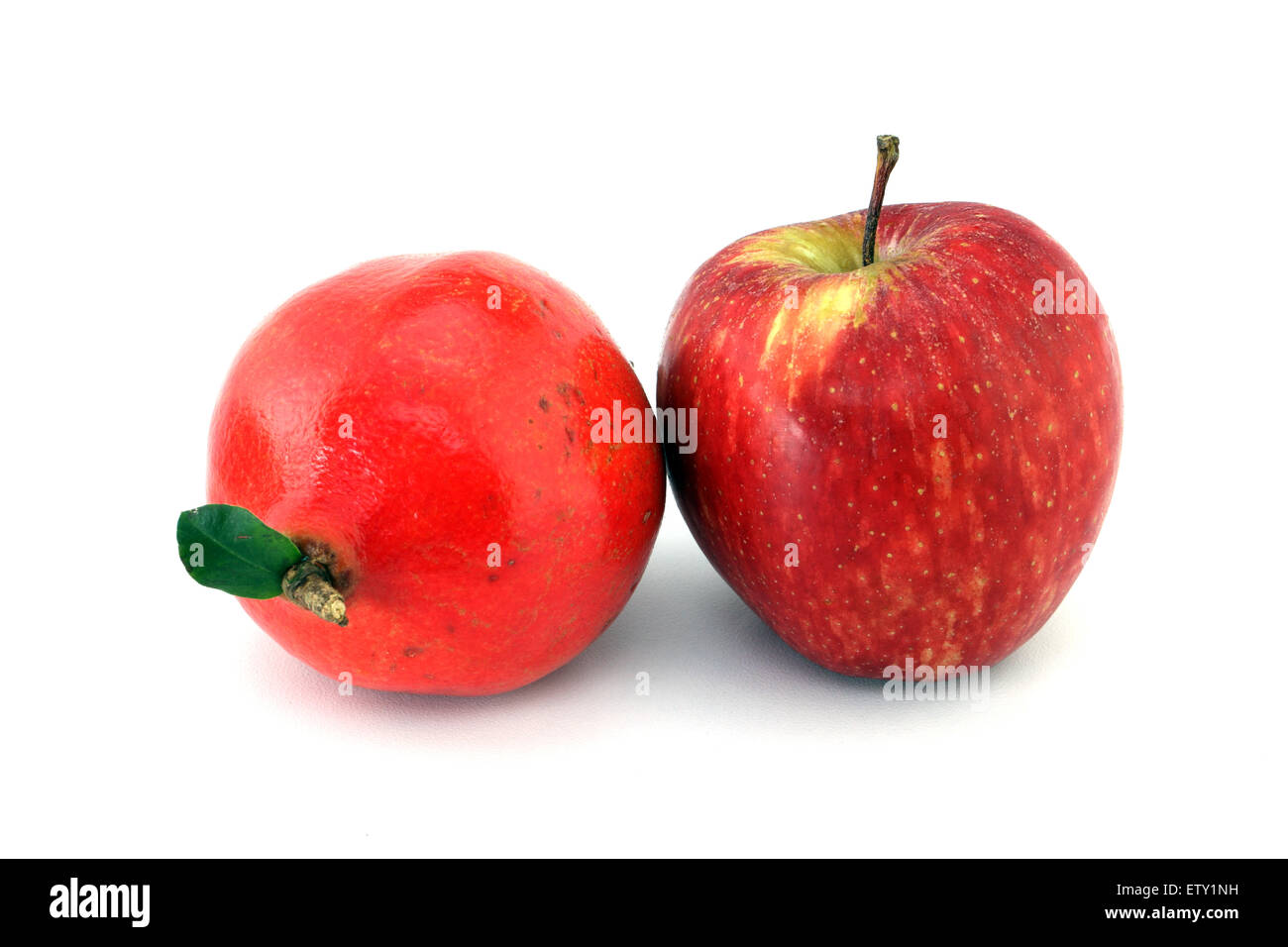 Apple and pomegranate on white background - Stock Image