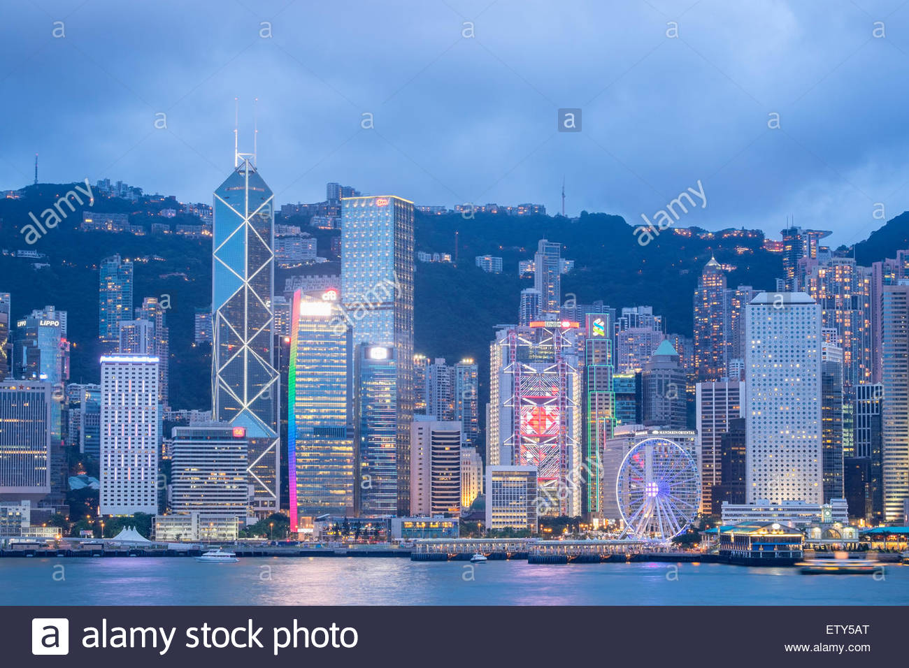 Dusk skyline of skyscrapers in Hong Kong from Kowloon on a clear day - Stock Image