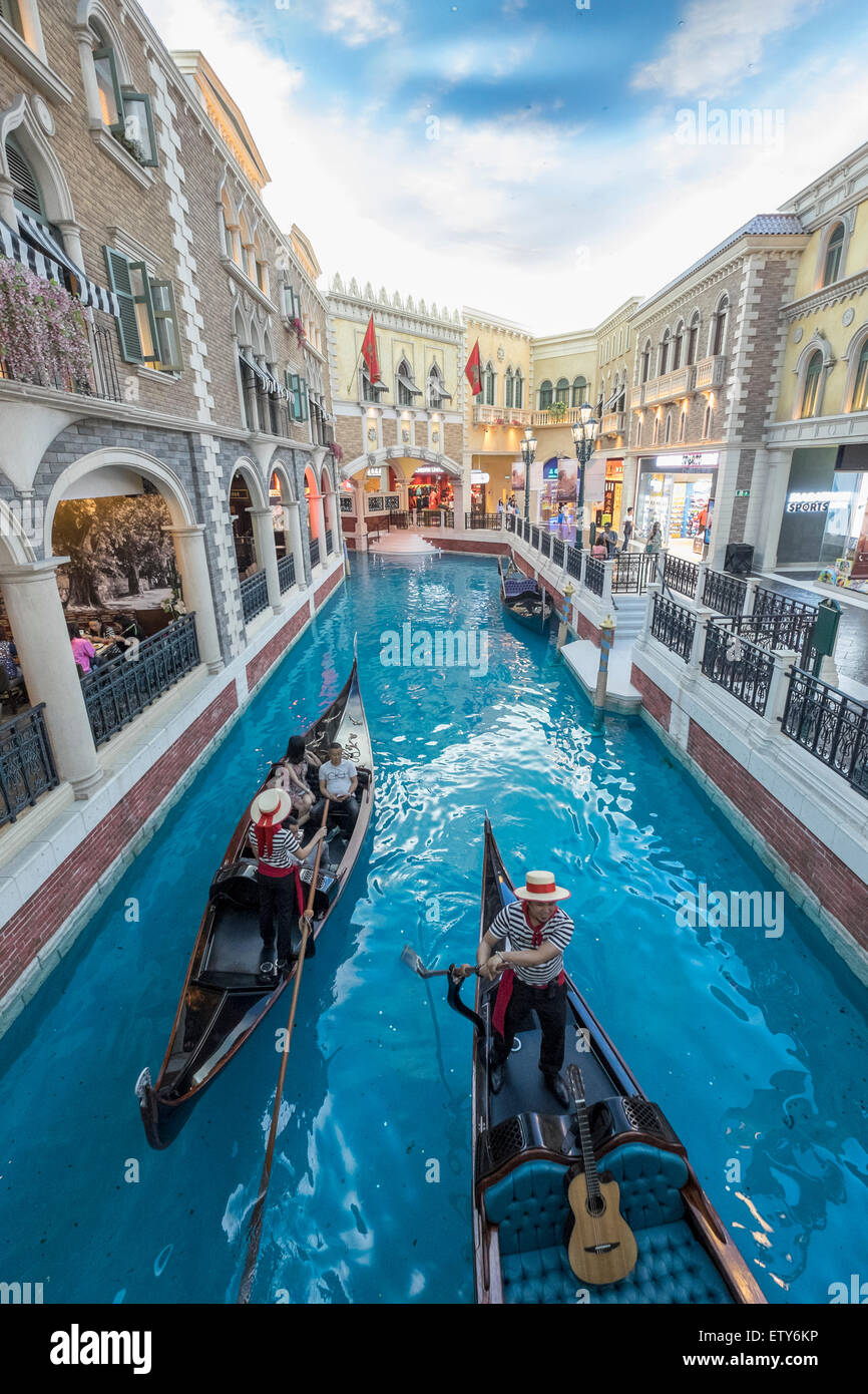 Canal and Gondolas on canal inside The Venetian Macao  casino and hotel in Macau China - Stock Image