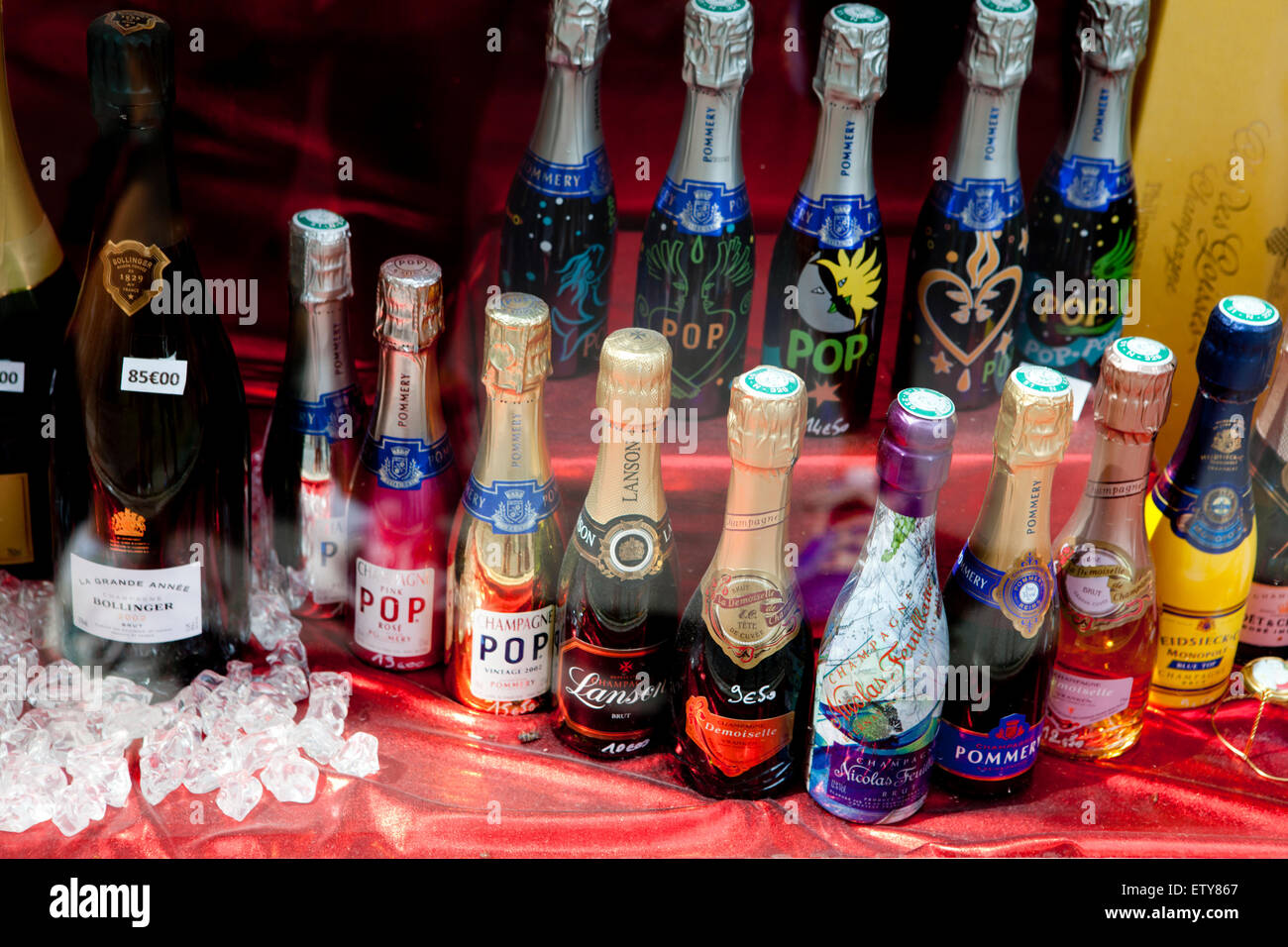 Different sort of Champagne bottles on sale in a shop in Rheims - Stock Image