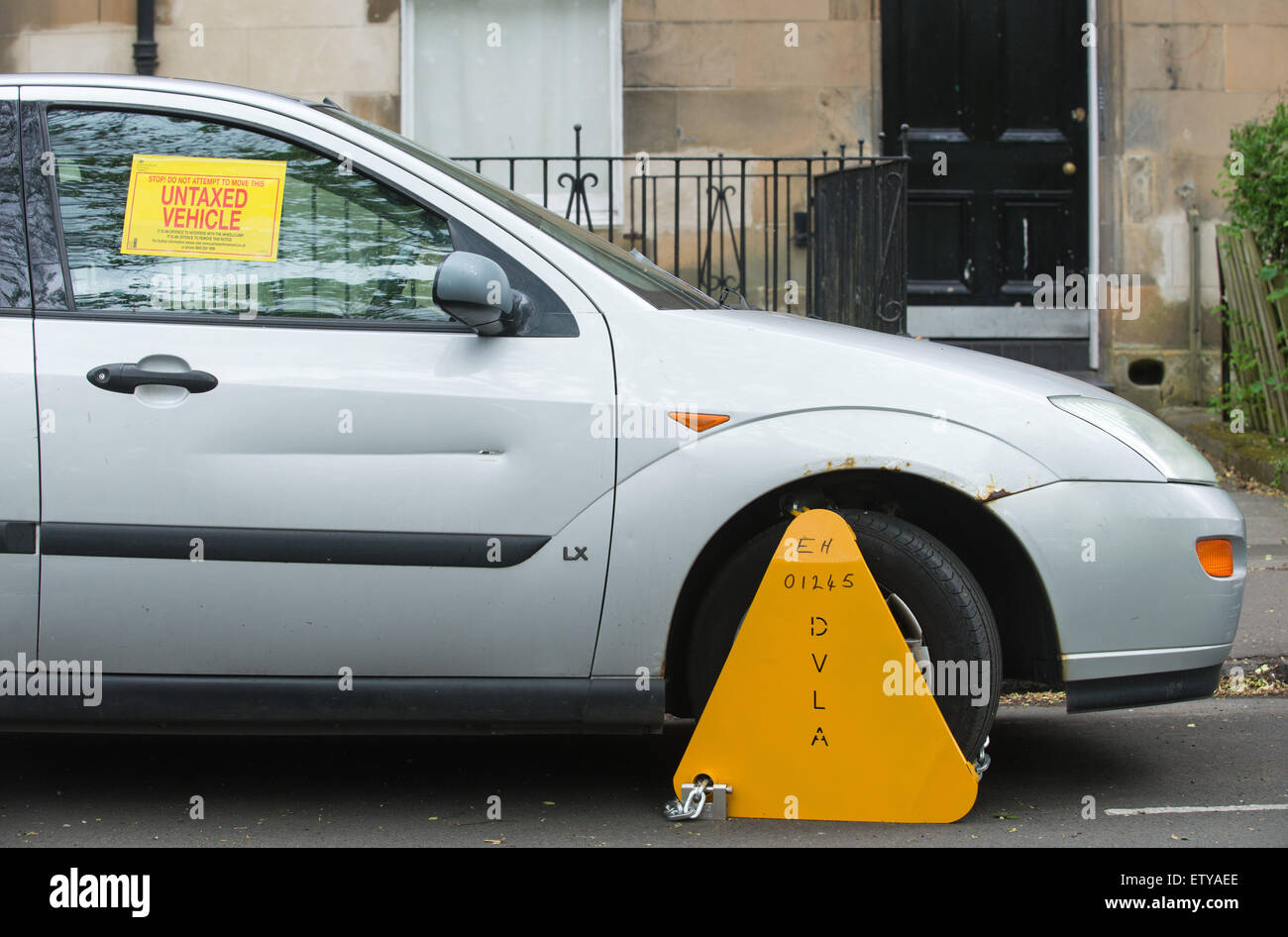 Wheel Clamp on an untaxed vehicle ( Ford Focus ) in Edinburgh, Scotland.  picture by Alex Hewitt Stock Photo