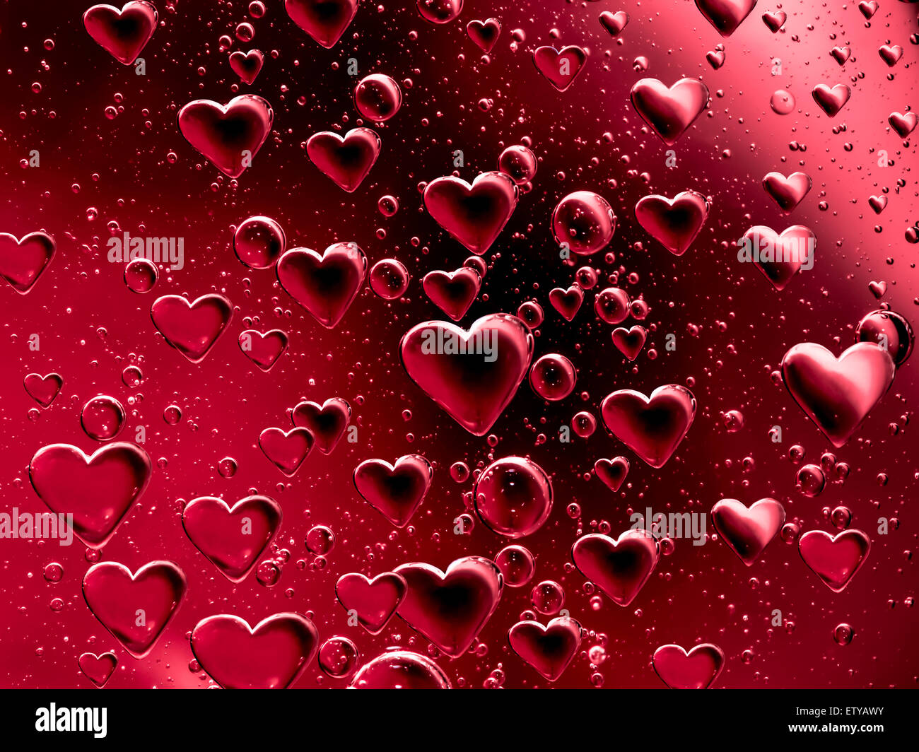 Floating heart shaped bubbles - Stock Image