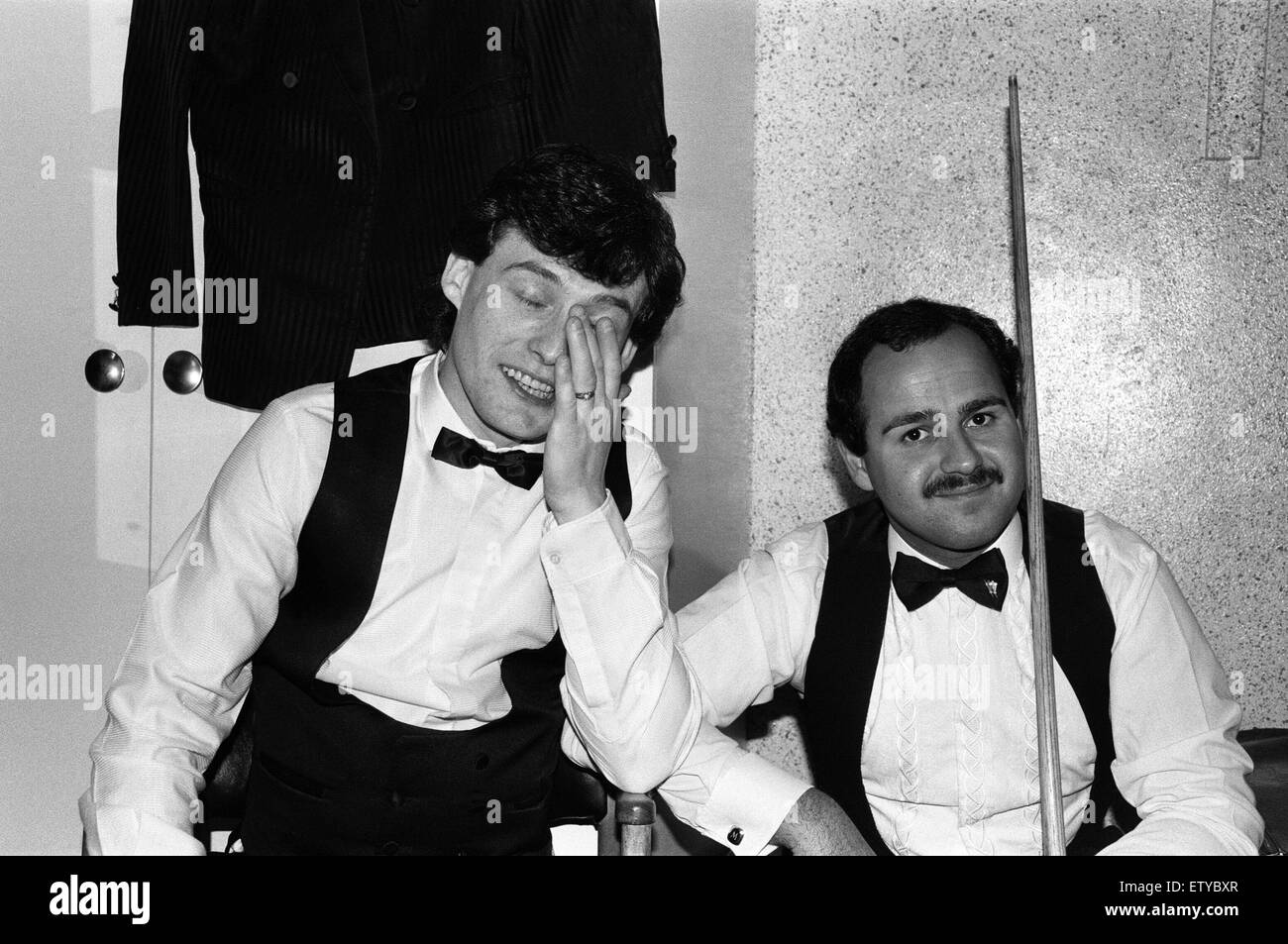 Snooker player jimmy whiteshares a joke with a fellow snooker player in the dressing room