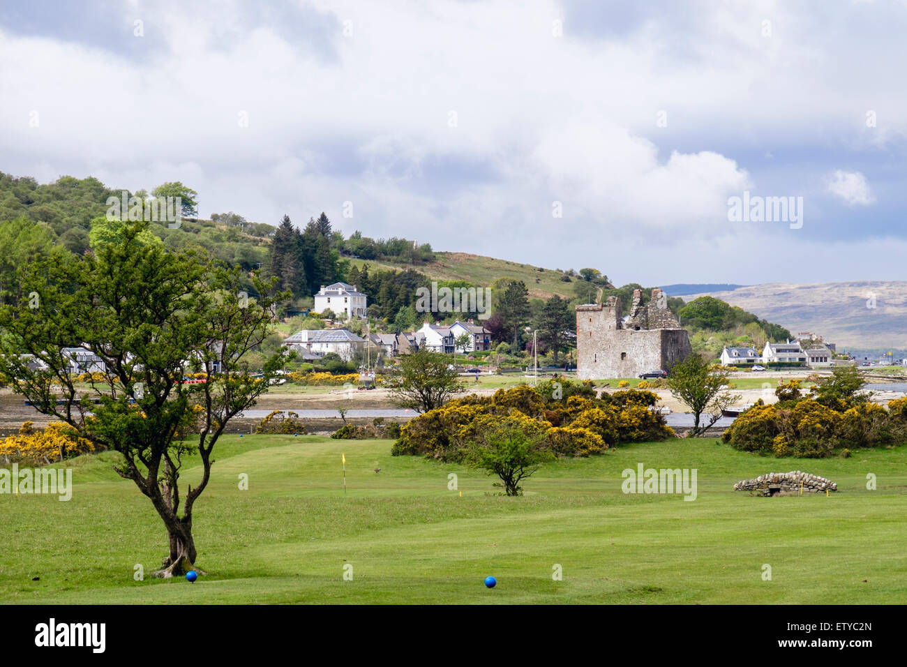 View across golf course to village and castle ruins in Lochranza, Isle of Arran North Ayrshire Western Isles Scotland - Stock Image