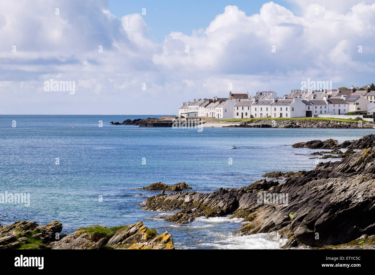 View along rocky coast of Loch Indaal to Islay village. Port Charlotte, Isle of Islay Inner Hebrides Argyll & - Stock Image