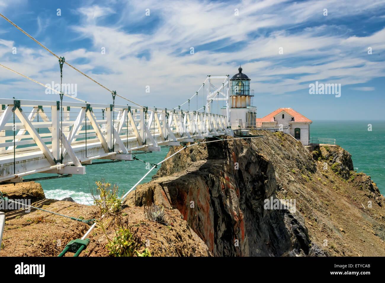The bridge to Point Bonita Lighthouse on the rock, under beautiful sky, San Francisco, California - Stock Image