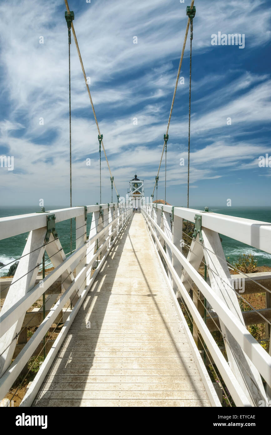 The bridge to Point Bonita Lighthouse under beautiful sky, San Francisco, California - Stock Image