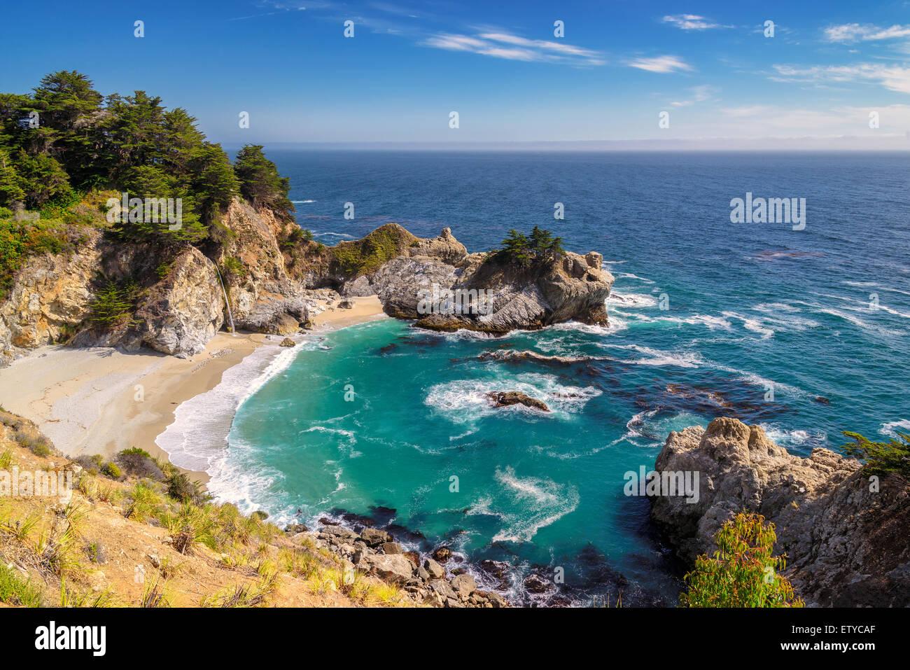 Fine beach and falls on Pacific coast, Julia Pfeiffer beach, Big Sur. California, USA - Stock Image