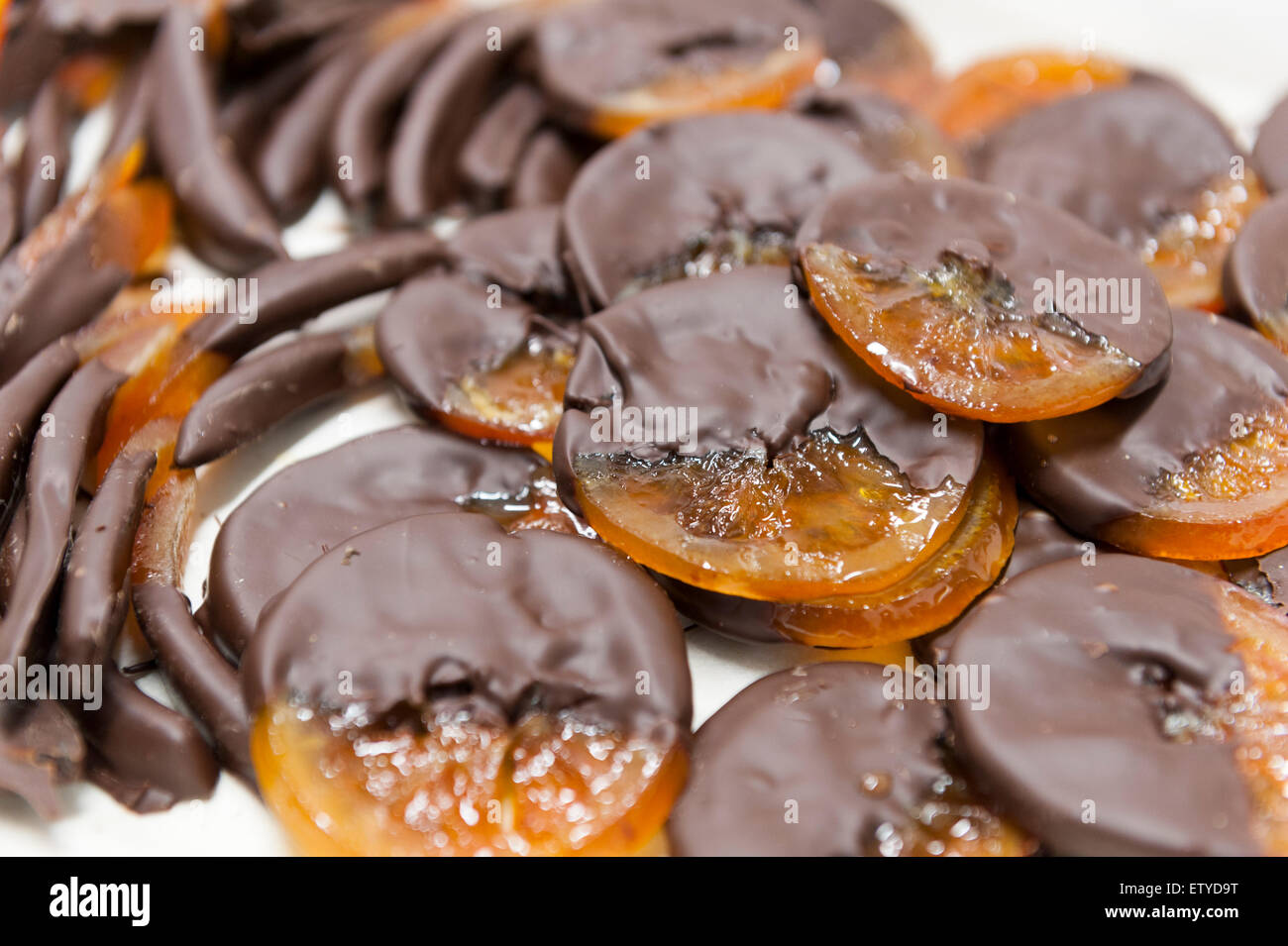 orange peels coated with dark chocolate - Stock Image