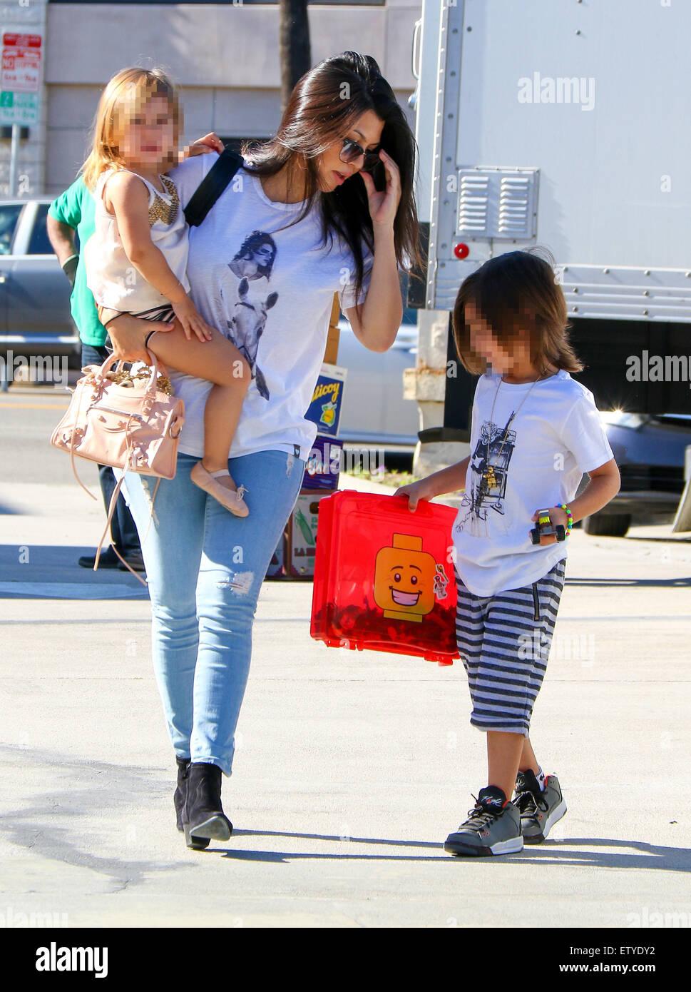 Kim Kardashian is back to black hair as she and Kourtney take their