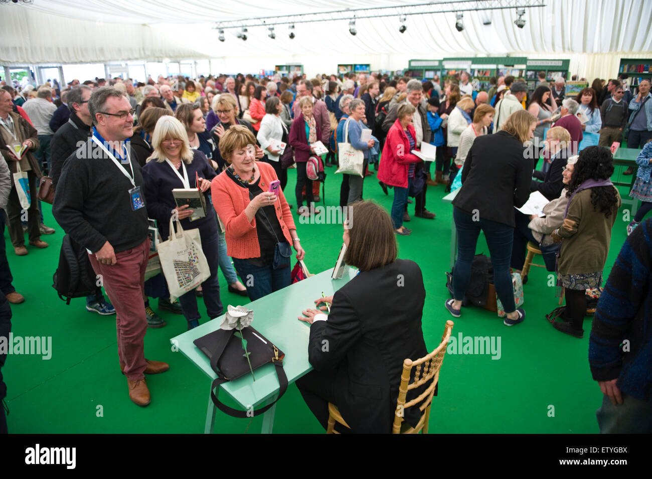 Authors surrounded by crowds of fans book signing in bookshop at Hay Festival 2015 - Stock Image