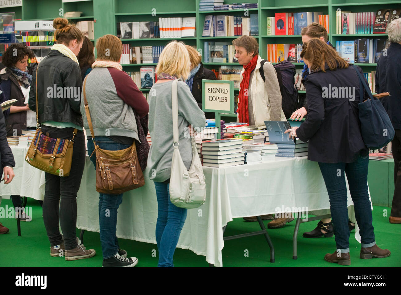Visitors browsing author signed copies of books in bookshop at Hay Festival 2015 - Stock Image