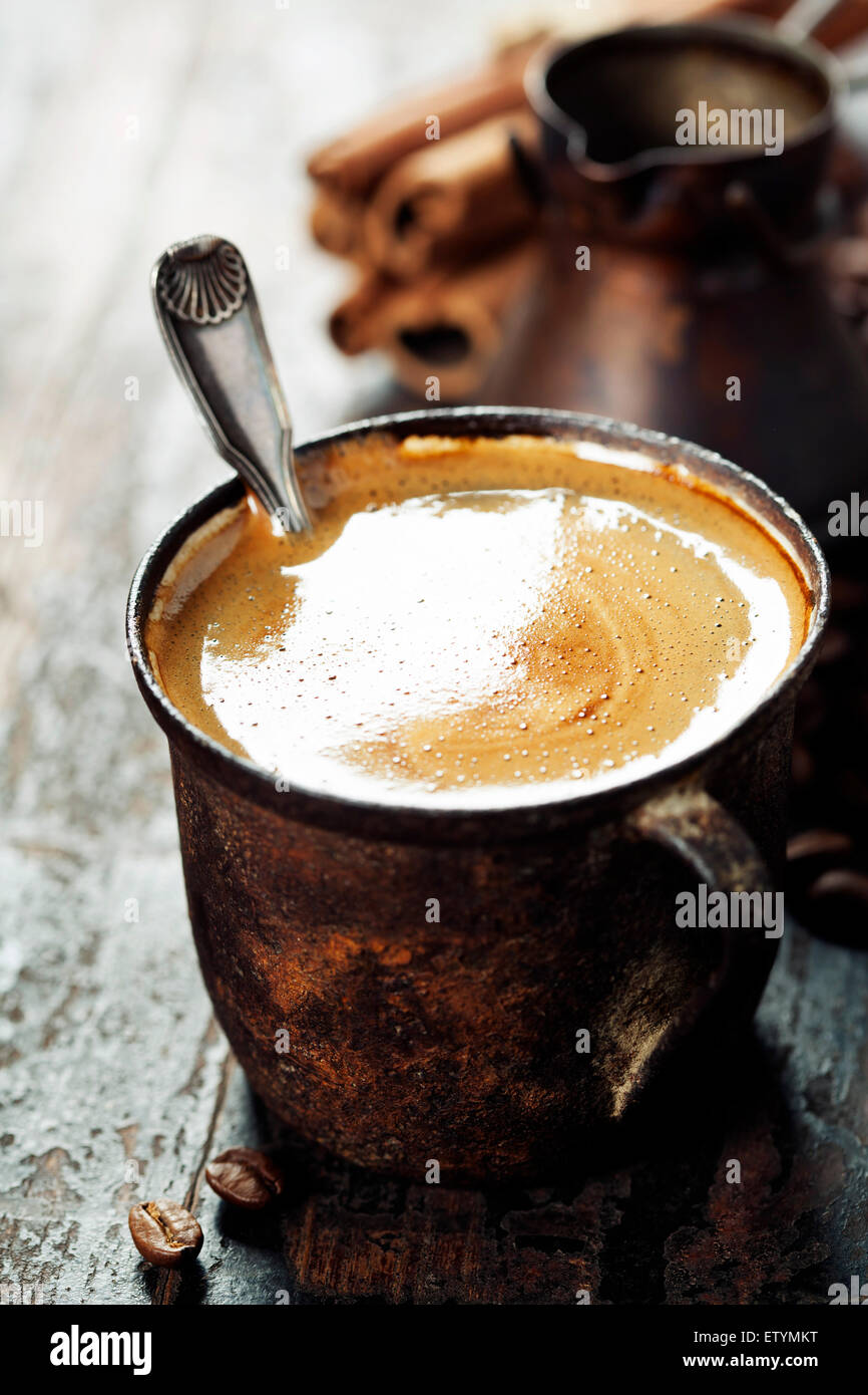 Old coffee cup on dark rustic  background - Stock Image