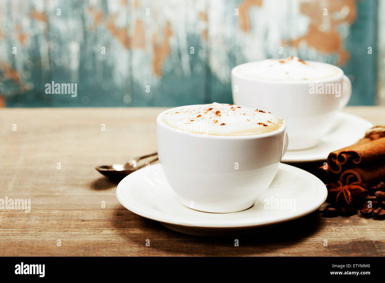 Two cups of coffee on old wooden table - Stock Image