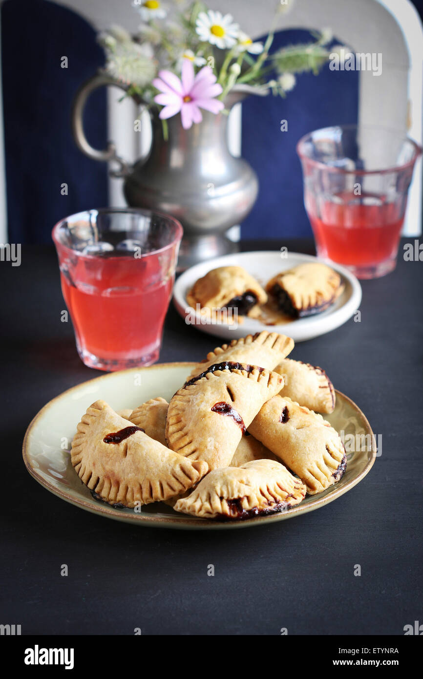 Freshly baked hand made cherry pies - Stock Image