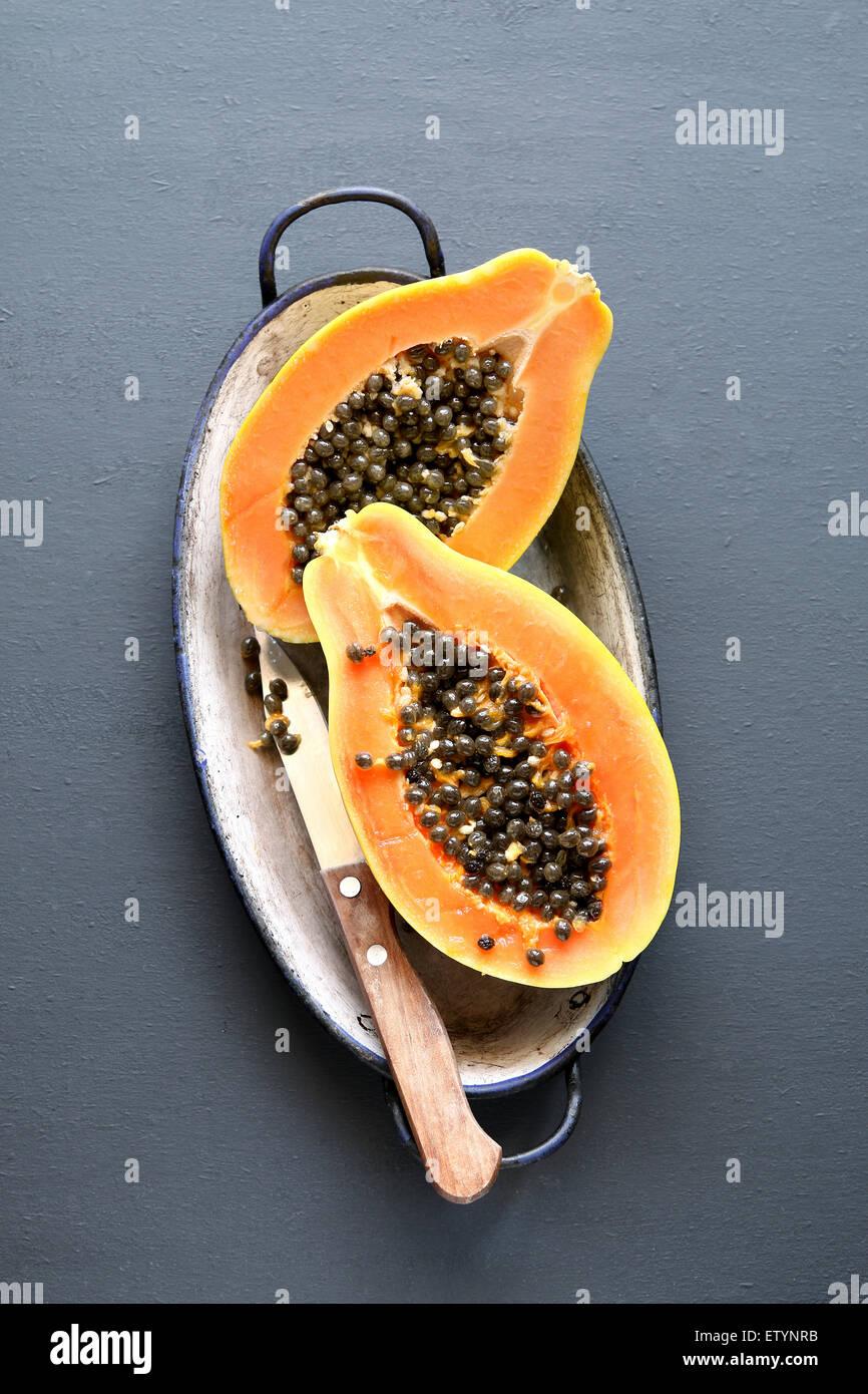 Sliced fresh papaya fruit on an enamel plate - Stock Image