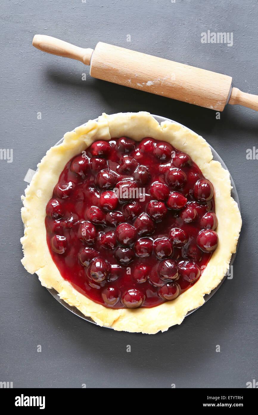 Unbaked cherry pie - Stock Image