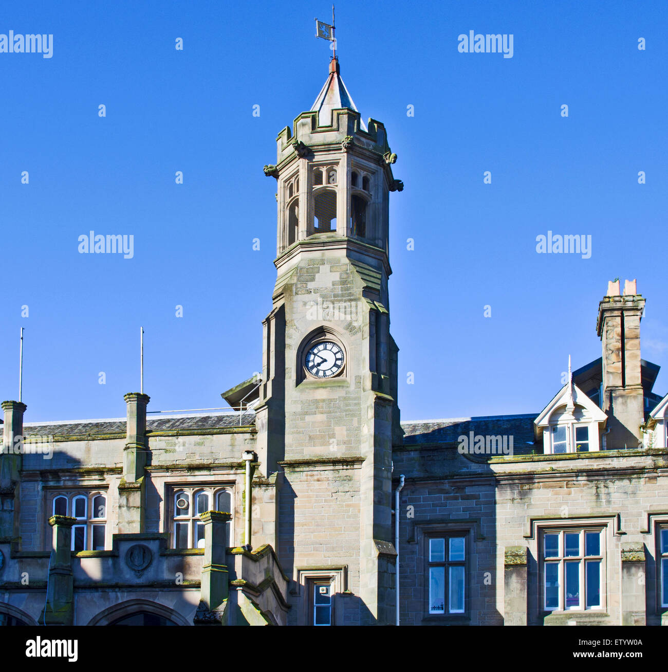 Detail of exterior frontage and Clock Tower of Carlisle city railway station (Citadel station), built 1847 in neo - Stock Image