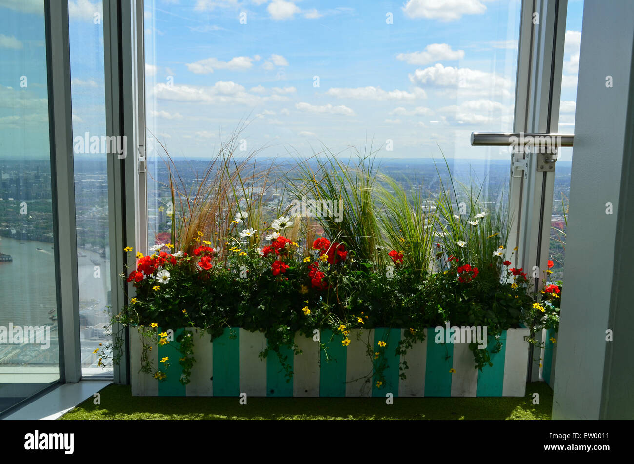 Window box in a high rise appartment - Stock Image