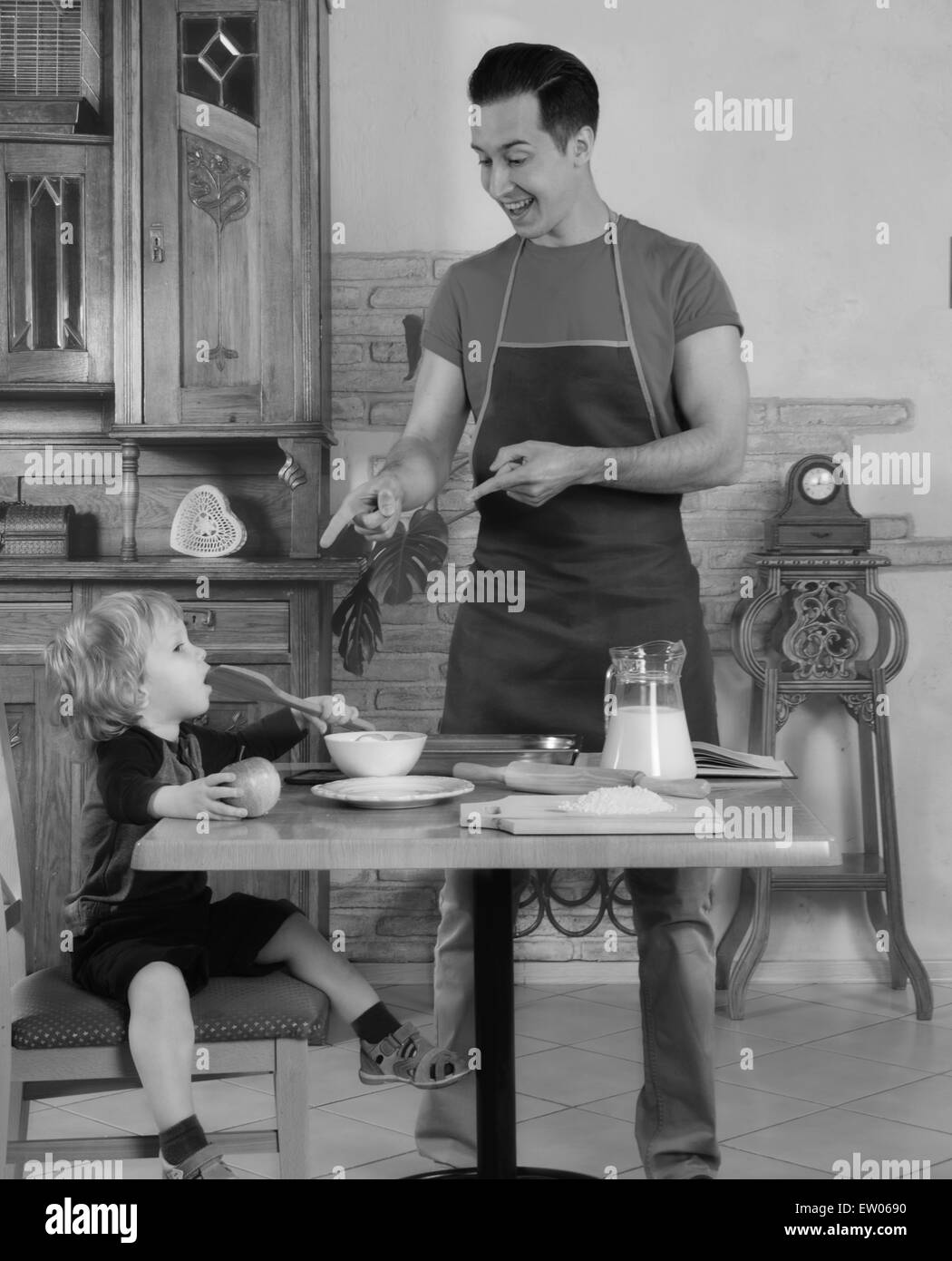 Dad cooks a breakfast - Stock Image