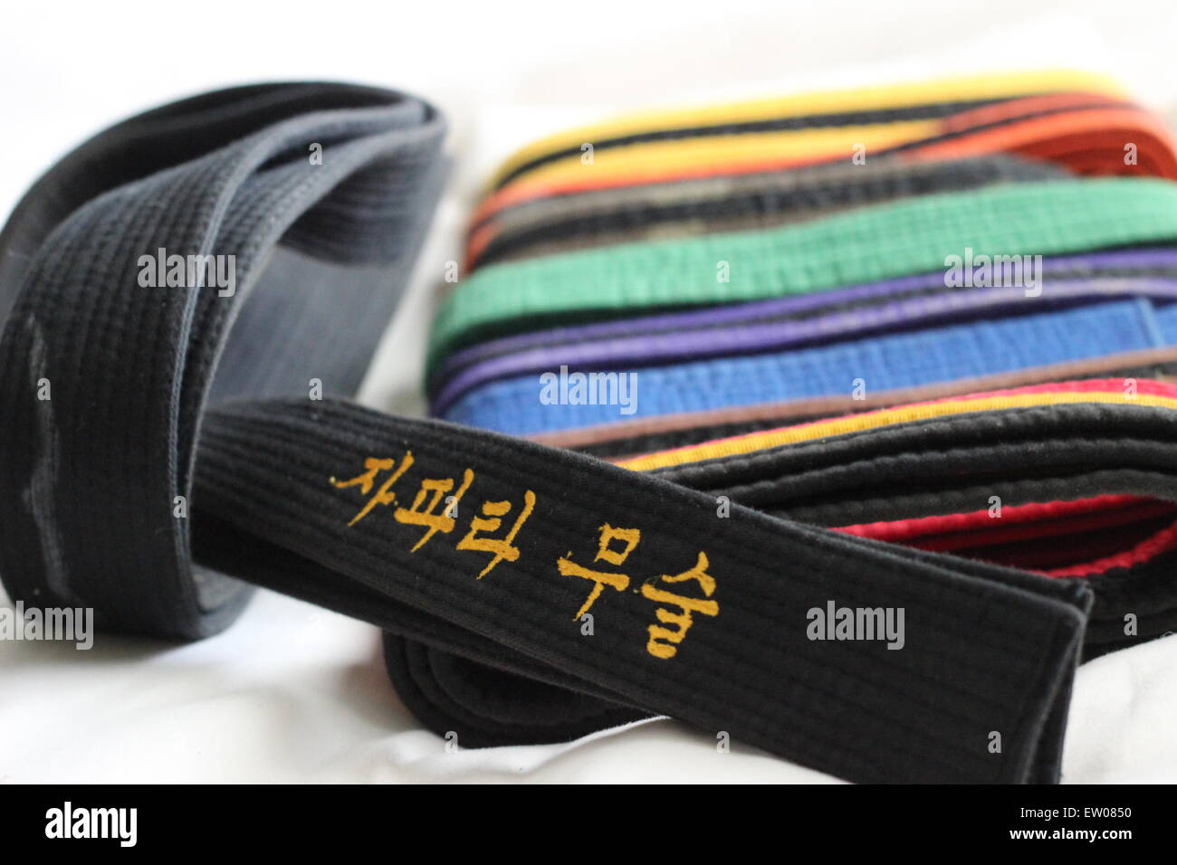 A pile of taekwondo belts. - Stock Image