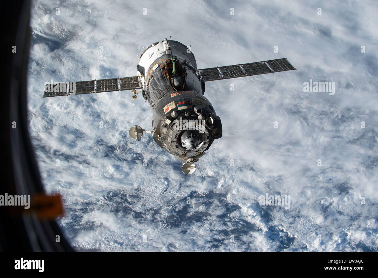 The Russian Soyuz TMA-15M spacecraft carrying Expedition 43 crew back to Earth disengages from the International - Stock Image