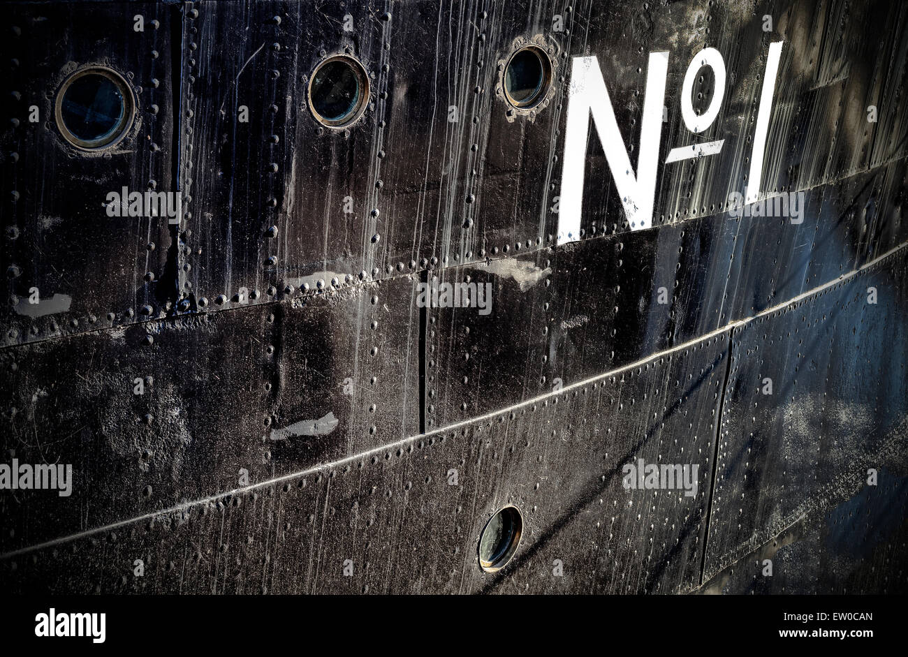 Photo of a number one sign on a grungy metal ship side, space for text. - Stock Image