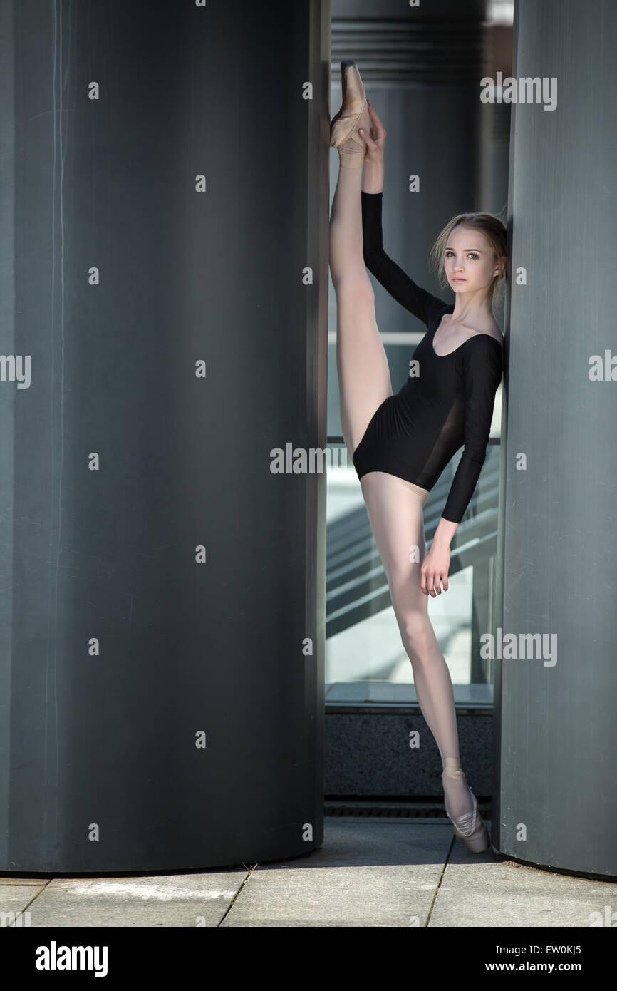 Young graceful ballerina in black bathing suit Stock Photo