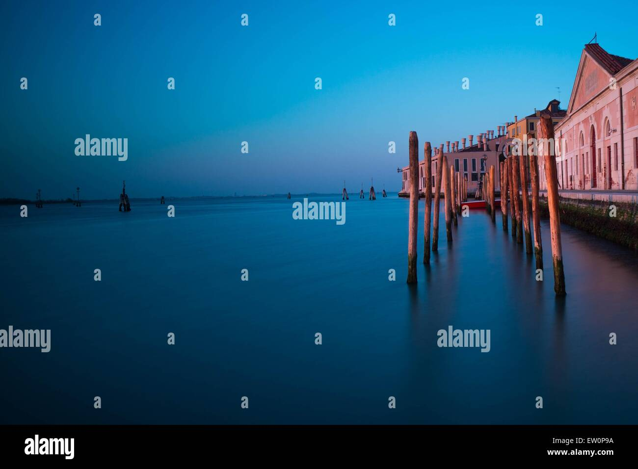A Venice gondola / boat dock, shot with a ND filter during sunset. - Stock Image