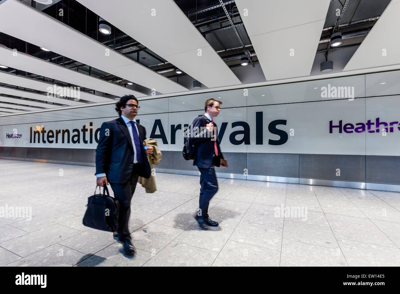 Business Travellers Arriving At Heathrow Airport, London, England - Stock Image