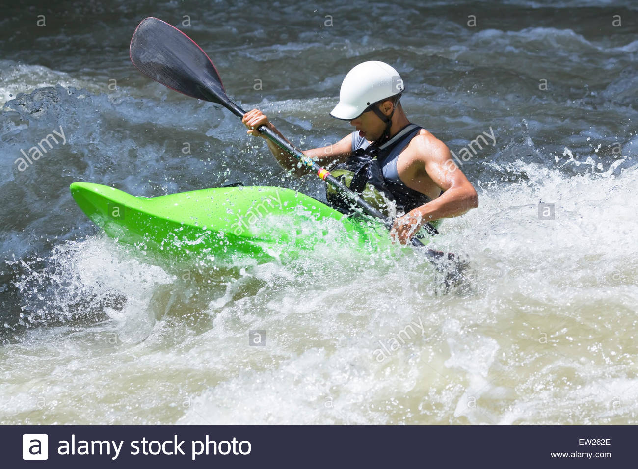Kayak surfing in whitewater, Pacuare river, Turrialba, Costa Rica, Central America - Stock Image
