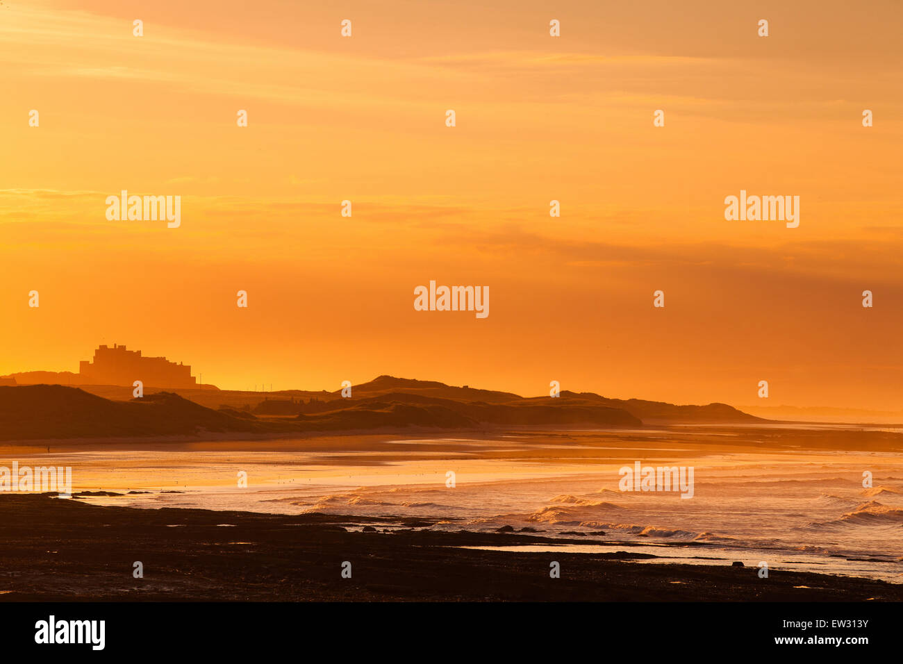 View of the  Bamburgh castle in a spectacular sunset from the Seahouses,Great Britain - Stock Image